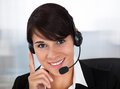 Callcenter employee with headset happy young female wearing in office Stock Photo
