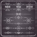 Calligraphic design elements set on chalkboard vintage retro background page decoration dividers text Royalty Free Stock Images