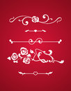 Calligraphic elements with hearts isolated on red background