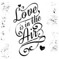 Love is in the air. Calligraphic lettering, grunge style.