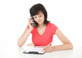 Calling beautiful assistant writing at clipboard