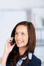 Calling businesswoman close up of happy talking through cellular phone Royalty Free Stock Image