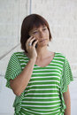 Calling pretty woman talking on mobile phone Royalty Free Stock Images