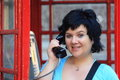 Calling woman the from the traditional english red phone booth Royalty Free Stock Images