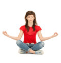 Calm attractive teenage girl in lotus pose bright picture of Stock Photography