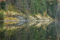 Calm autumn forest lake reflection Royalty Free Stock Photo