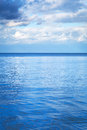 Calm Baltic sea with blue sky. Stock Images