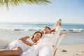 Calm couple napping in a hammock at the beach Royalty Free Stock Photo