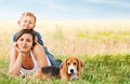 Calm family leisure scene on the meadow green Stock Images