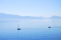 Calm ionian sea waters with sailing yachts Royalty Free Stock Photo