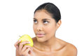 Calm nude brunette holding green apple on white background Stock Photography