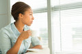 Calm pastime copy spaced image of a black woman with a cup of tea resting at home Stock Photography