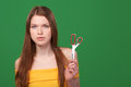 Calm redhead woman holding scissors Royalty Free Stock Photo