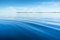 Calm sea waves behind the ship in water the view from the height of the water surface Royalty Free Stock Image