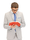 Calm and serious man with book bright picture of Stock Photography