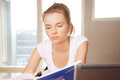 Calm and serious teenage girl with big notepad Royalty Free Stock Image