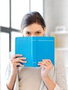 Calm and serious woman with book bright picture of Stock Images