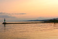 Calm Waters at Sunset on a Harbor Breakwater Royalty Free Stock Photo
