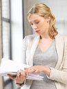 Calm woman with documents indoor picture of Royalty Free Stock Photo