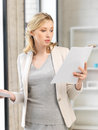Calm woman with documents indoor picture of Stock Photos