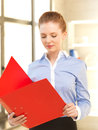 Calm woman with documents indoor picture of Stock Photography