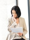 Calm woman with documents indoor picture of Royalty Free Stock Photos