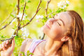 Calm woman enjoying nature closeup portrait of beautiful spring with closed eyes having fun outdoors pleasure concept Stock Photo