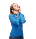 Calm young woman with headphones music and technology concept closed eyes listeting to music Royalty Free Stock Photos