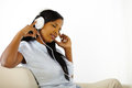Calm young woman listening to music Stock Photography