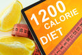 Calorie diet on tablet fat lost concept Stock Photo