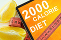 Calorie diet on tablet fat lost concept Royalty Free Stock Image