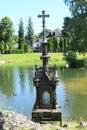 Calvary with pond and Castle Liptovsky Hradok