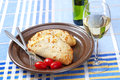 Calzone bread, tomatoes and white wine Stock Photography