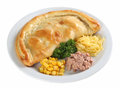 Calzone pizza on a plate with parsley corn salmon and cheese Royalty Free Stock Image