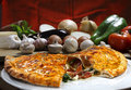Calzone pizza with vegetables roasted in the wood oven Royalty Free Stock Photo