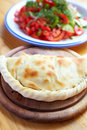 Calzone and salad b close up closed italian pizza on the wood table Royalty Free Stock Image