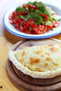 Calzone and salad close up closed italian pizza on the wood table Royalty Free Stock Photography