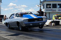 Camaro wheelie napierville dragway canada june this chevrolet on at the starting line at heads up challenge event Stock Photos