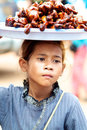 Cambodia kid selling food Royalty Free Stock Image