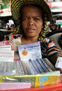 Cambodian book seller a woman selling books to tourists Royalty Free Stock Photos