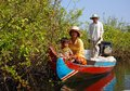 Cambodian family in a fishing boat on the sankger river from battambang to siem reap cambodia Royalty Free Stock Photography