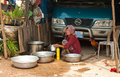 The cambodian life suburb sihanoukville cambodia february an elderly woman washes dishes on street Royalty Free Stock Photography