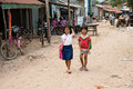 The cambodian life suburb sihanoukville cambodia february two small girls go home from school Stock Photos