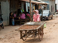 The cambodian life suburb sihanoukville cambodia february a woman sells on street local food Royalty Free Stock Photography