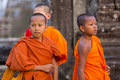 Cambodian monk kids in Angkor with orange traditional clothes