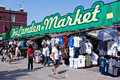 Camden market in london people walk past the on august town is s most popular open air area with stalls shops Royalty Free Stock Photo