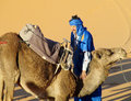 Camel and arab camel driver ready to ride in desert Royalty Free Stock Photo