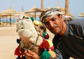 image photo : Camel owner portrait