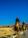 Camel riders in cario egypt this is a photograph of two or bedouin coming from the sahara desert december th giza cairo Stock Photo