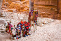 Camels in petra a pair of covered by colorful rugs jordan Stock Photography